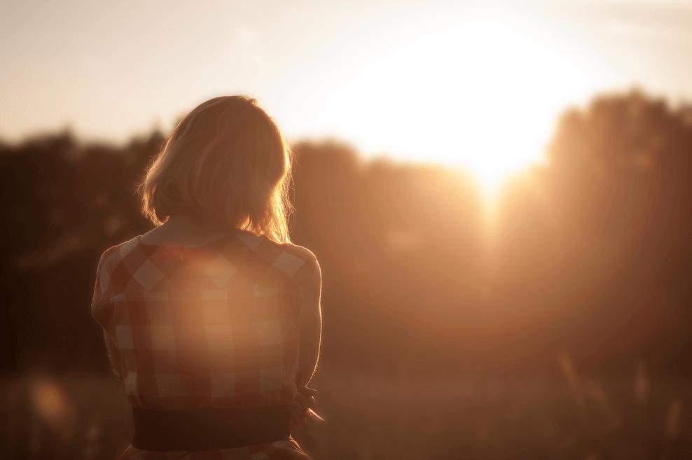 Girl sitting at sunset